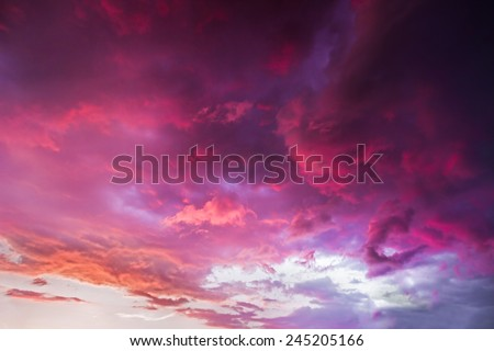 A dramatic and colorful cloudy sunset sky is photographed over Indiana. - stock photo