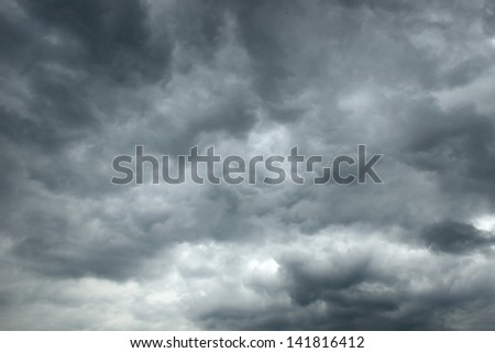 a dramatic sky scape of stormy skies - stock photo