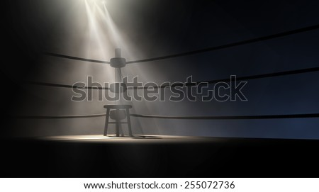 A dramatic view of the corner of an old vintage boxing ring with an empty stool spotlit by a single spotlight on an isolated dark background - stock photo