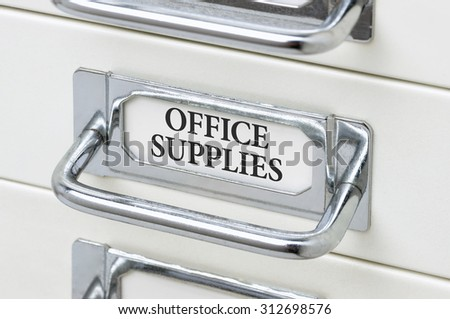 A drawer cabinet with the label Office Supplies - stock photo