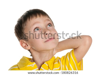 A dreaming little boy on the white background - stock photo