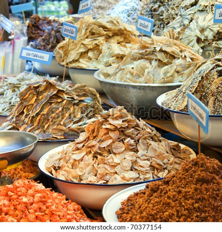 A dried seafood market stall situated in the town of Hua Hin in Thailand. - stock photo