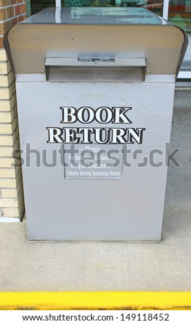 A drive up library book return bin/box outside the library - stock photo
