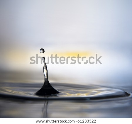 a drop of water splashed : silhouette of dancing woman - stock photo