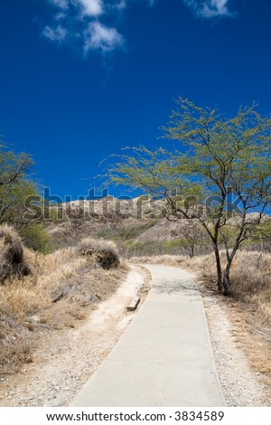 A dry path leading up to Honolulu's Diamond Head lookout. - stock photo
