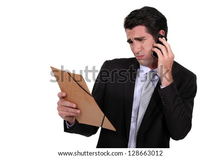 A dubious businessman over the phone. - stock photo