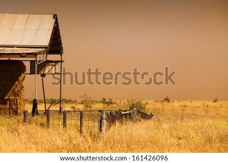 A dust storm hits farmland - stock photo