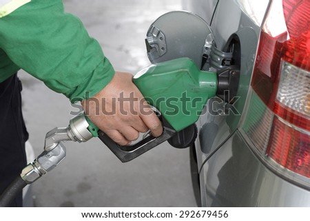 a duty refueling the car at a gas station
