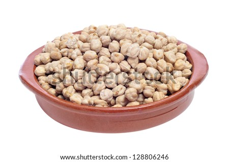 a earthenware bowl with dried chickpeas on a white background - stock photo
