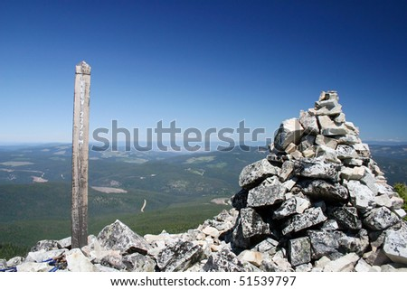 A elevation sign shows the 2272 Meters mark at the peak of mountain in manning park, Canada. - stock photo