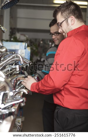 A employee of a hardware store at work. - stock photo