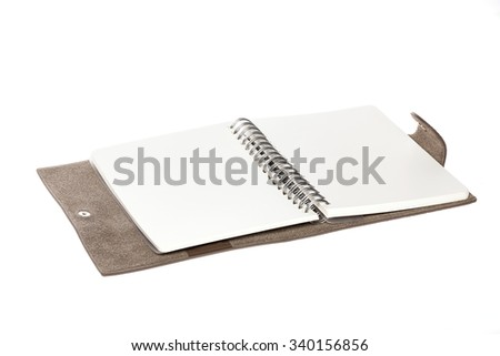 A empty(blank) brown(grey) leather diary spread, open close up isolated white. - stock photo