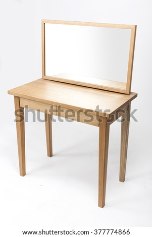 A empty(blank, vacant, hollow) wood dressing table(vanity) with mirror. - stock photo