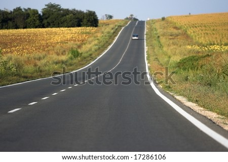 a empty road in the country - stock photo