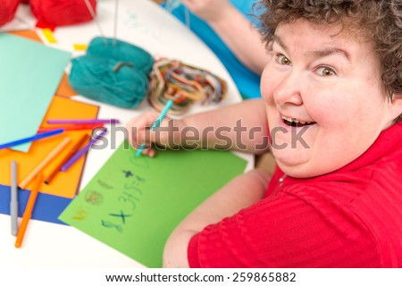 a Ergotherapy with a mentally disabled woman - stock photo