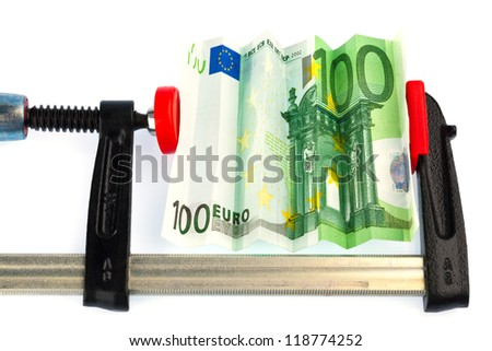a euro bank note in vise. economic and financial crisis. - stock photo