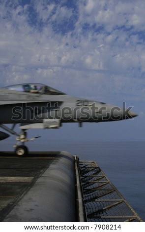 A F/A-18C Hornet Just Prior to Liftoff From the Nuclear Aircraft Carrier, USS Enterprise, with motion blur - stock photo