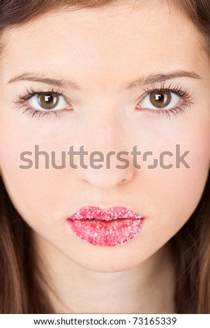 A face of a beautiful girl with sugar lips