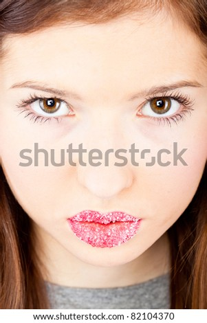 A face of a beautiful girl with sugar lips - stock photo