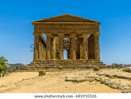 A face on view of the Temple of Concordia in the ancient Sicilian city of Agrigento in summer