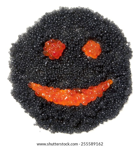 A face with a smile of red and black caviar - stock photo