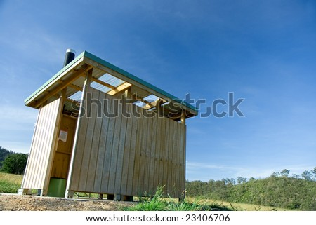 A fair dinkum outback dunny in an Australian forest reserve. A dunny is a toilet, for those who don't know. - stock photo