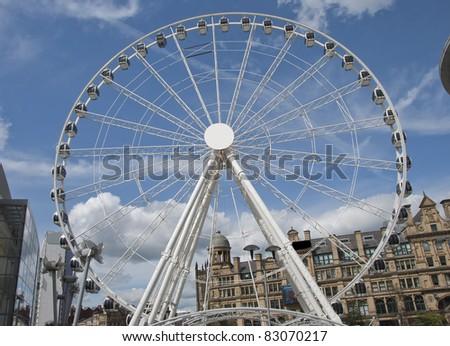 A Fairground Wheel on a city shopping plaza - stock photo