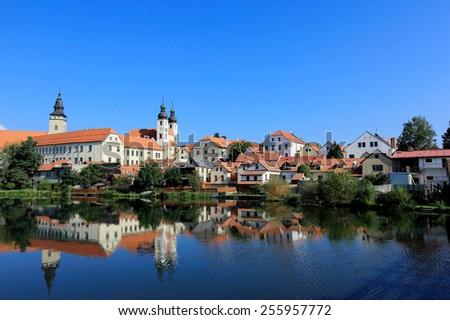 A fairy tale castle and old town city with lakeside mirror reflection ~ in Telc, Czech - stock photo