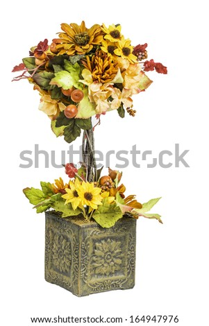 A Fall and Autumn colored flower arrangement showing various colors isolated on a white background. - stock photo