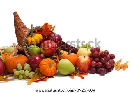 A Fall arrangement in a cornucopia on a white background