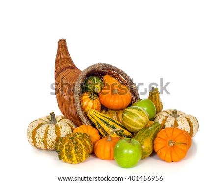 A fall or autumn cornucopia on white background.  Harvest horn of plenty. - stock photo