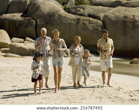 A family at the beach. - stock photo