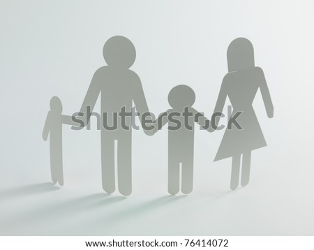 A family cutout shape isolated against a white background - stock photo