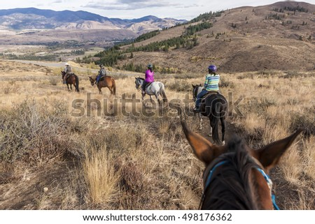 A family follows behind a guide on Sun Mountain near Winthrop, Washington.