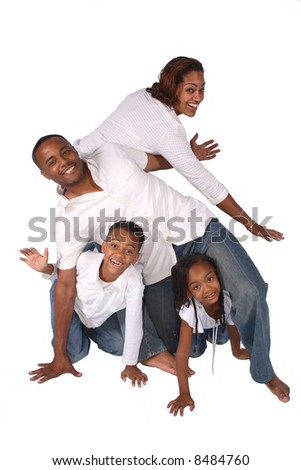A family having fun together posing in a twisted pose