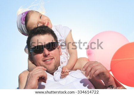 a family having good time in front of a sea - stock photo