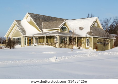 A family home snowed in after a snow storm. - stock photo
