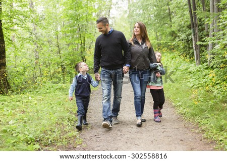 A family in forest on a meadow
