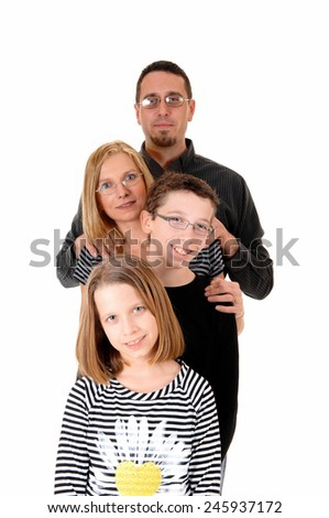 A family standing isolated on white background, dad, mother, daughter and son, standing behind each other.  - stock photo
