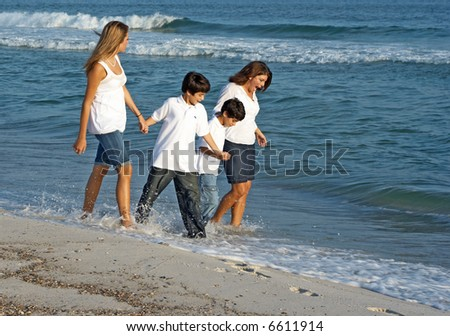 A family walking together on the Alabama gulf coast. - stock photo