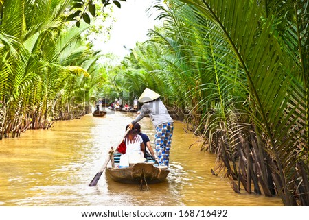 A famous tourist destination is  Ben Tre village in Mekong delta , Vietnam. Mekong Delta is home of people who live along the many channels. - stock photo