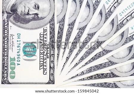 A fan of a hundred dollar bills - stock photo