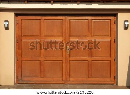 A fancy new garage door - stock photo