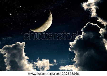 A fantasy of night sky cloudscape with stars and a crescent moon overlaid, vintage color toned - stock photo