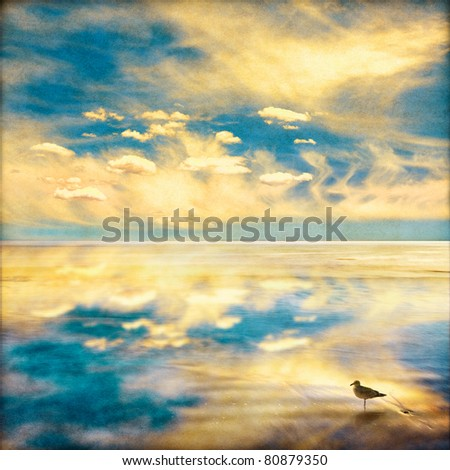 A fantasy sky and clouds seascape with a dreamy vintage look.  Image displays a pleasing paper grain and fiber texture at 100%. - stock photo