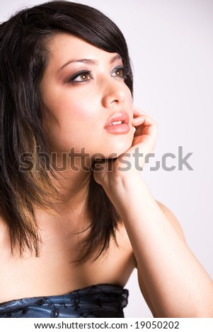 A fashion shot of a beautiful asian girl - stock photo