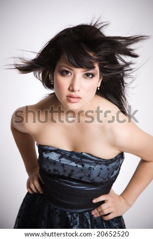 A fashion shot of a beautiful asian girl