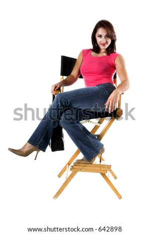 A fashionable young woman istting in a directors chair
