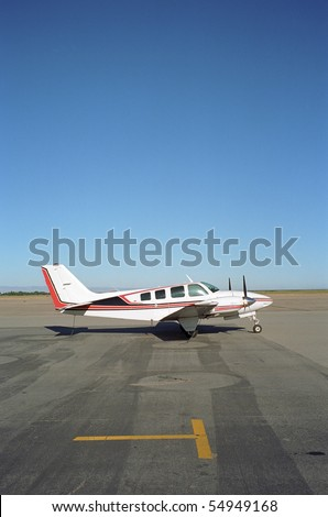 A fast modern twin-engine aircraft with space for text within image - stock photo