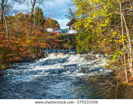 A fast moving stream with a small waterfall during Autumn in the Pocono Mountains of Pennsylvania. - stock photo